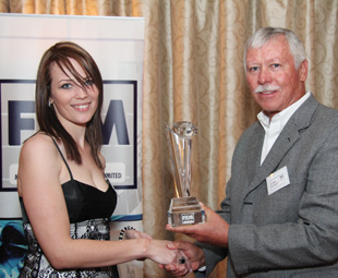 Meyerine Van Zyl (Kentz (Pty) Ltd), receives her platinum award from Nico Maas, Chairman FEM.