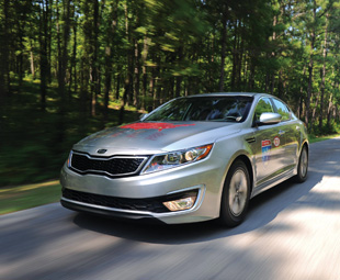 "The new Kia Optima Hybrid set a Guinness World Record recently for the ""lowest fuel consumption driving through all 48 contiguous U.S. states in a gasoline hybrid car""."