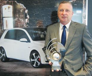 MD of VWSA, David Powels, with the company's thrid consecutive SJM Flex Environmental Award.