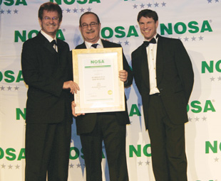 Giovanni Lodetti, industrial director at NPC-Cimpor, receives his award from Justin Hobday and Duncan Carlisle.