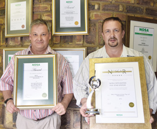 Louis Blom, sales and marketing executive (left), and Howard Eldridge, operations executive, show off Wilec's slew of Noscar and Nosa grading awards.