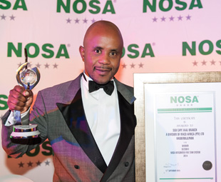 A proud Thabo Modumaela – SGB-Cape's national health, safety and environmental manager – showing off the company's accolades.