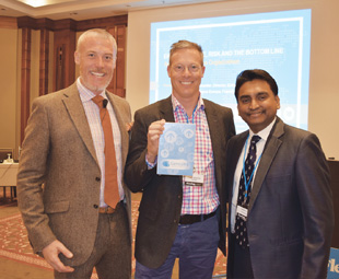 Daniel Meissner, global HSE director for Chemetall (centre), won an iPad at the conference, courtesy of Gensuite. He is flanked by Andrew Sharman, conference chairman, and Gensuite's Naveen Ghodkay.